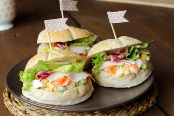 Russian salad sandwiches in a party table