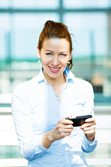 Business woman sending text message on phone