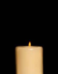candle with flame isolated on black