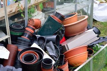 Large pile of empty plant pots