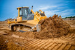 Excavator working with earth and sand in sandpit - 66314424