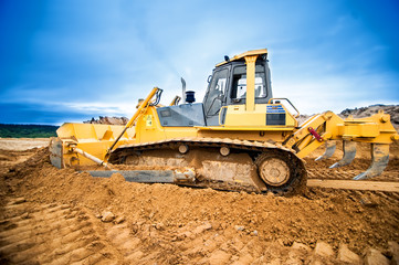Excavator working and moving earth in construction site