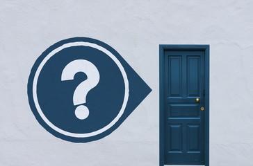 question next to a blue door