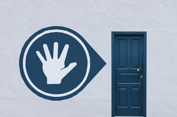 hand sign next to a blue door