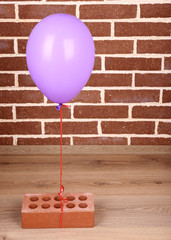 Color balloon with brick on wall background
