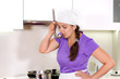 Attractive woman chef standing tasting the food