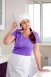 Attractive female chef sampling the recipe