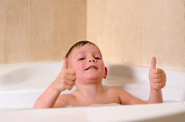 Cute little boy playing in the bath