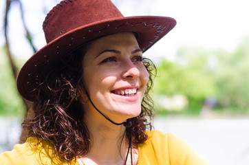 Beautiful woman in a trendy leather hat