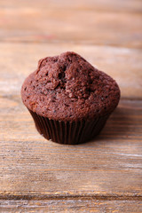 Chocolate muffin on wooden background
