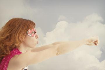 Superhero girl pretending to be flying