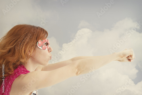 Superhero girl pretending to be flying плакат