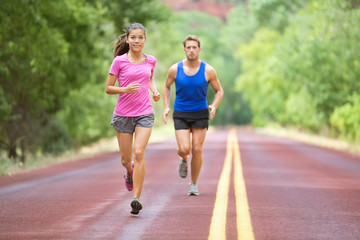 Sport - couple running on road training marathon