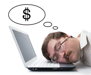 employee at the computer dreaming currency