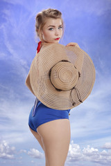 Pinup style young woman going to tan