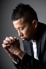 Man pray with cross