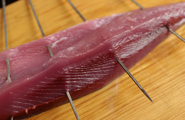 Skewered sliced bonito, close up