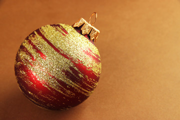 Beautiful Christmas ball on brown background