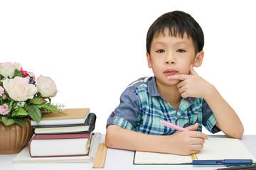 Student boy thinking between doing homework