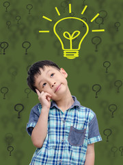 Young Asian boy thinking isolated on green background with bulb