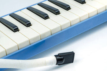 Close up  Melodica Isolated on White  : Clipping path included