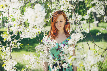 Beautiful girl in spring blossom