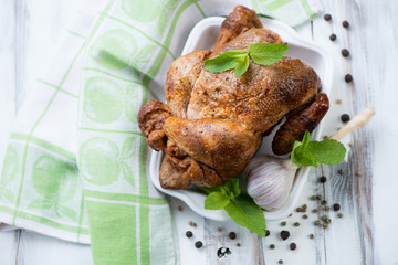 Smoked chicken with various spices, studio shot, high angle view