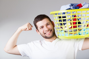 Happy man doingg laundry