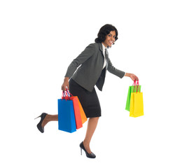 indian business woman running while shopping