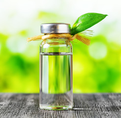 Vial of liquid on nature background