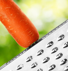 Ripe carrot rubbing on a grater