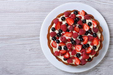 tart with fresh strawberries, raspberries and currants