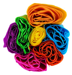 Rolls of various color paper on white background