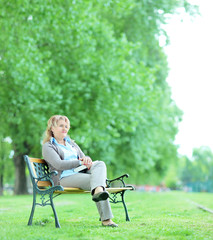 Mature woman sitting alone in the park
