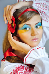 Portrait of a woman with creative makeup Ukrainian flag