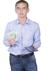Man with tablet and dollars in hands.