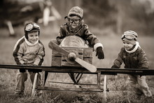 "Постер, картина, фотообои ""Young aviators at the airport with a homemade airplane"""