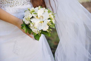 Bride holding a beautiful white bouquet