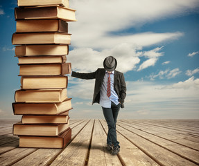 Man leaning books