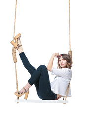 Beautiful girl swinging on swing. Isolated