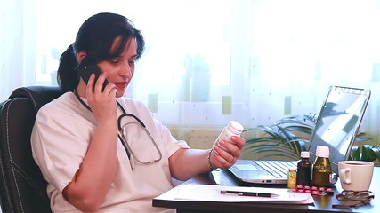 Doctor talking to patient on the phone about medicine