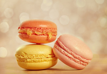 French macarons on a wooden background with retro filter effect