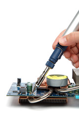 Soldering iron in hand and electric board on a white background.
