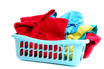Clothes in plastic basket isolated on white.