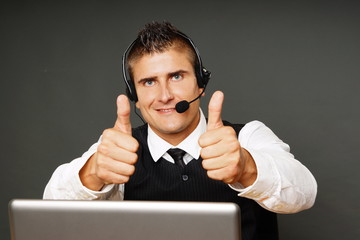 Young customer service operator shows you thumbs up