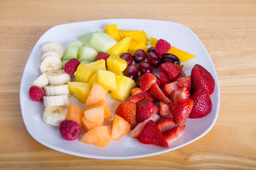 Cut Fruit with Mangos Bananas Berries Melons and Pineapple