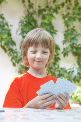 Boy with Blond Hair Playing Cards