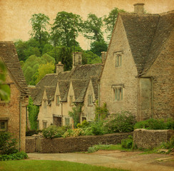 Bibury in spring. Traditional Cotswold cottages in England, UK.