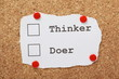 Tick Boxes for Thinker or Doer on a cork notice board