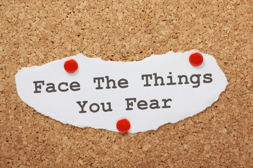 The phrase Face The Things You Fear on a notice board